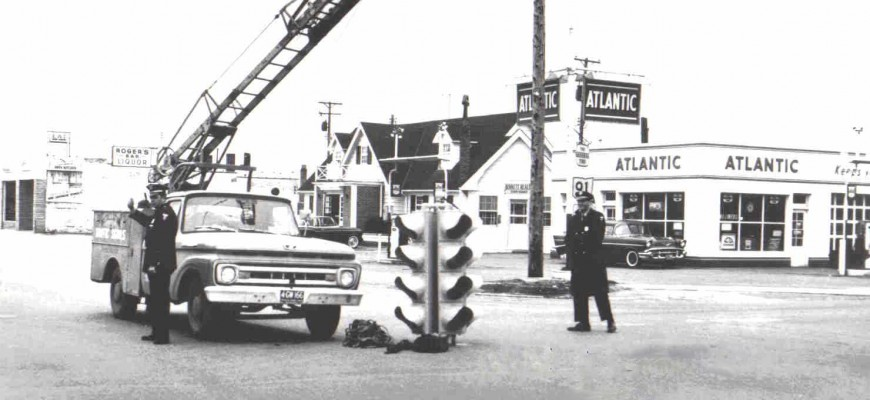 Traffic light being installed at the intersection of Aurora Rd and SOM Center Rd - 1960s